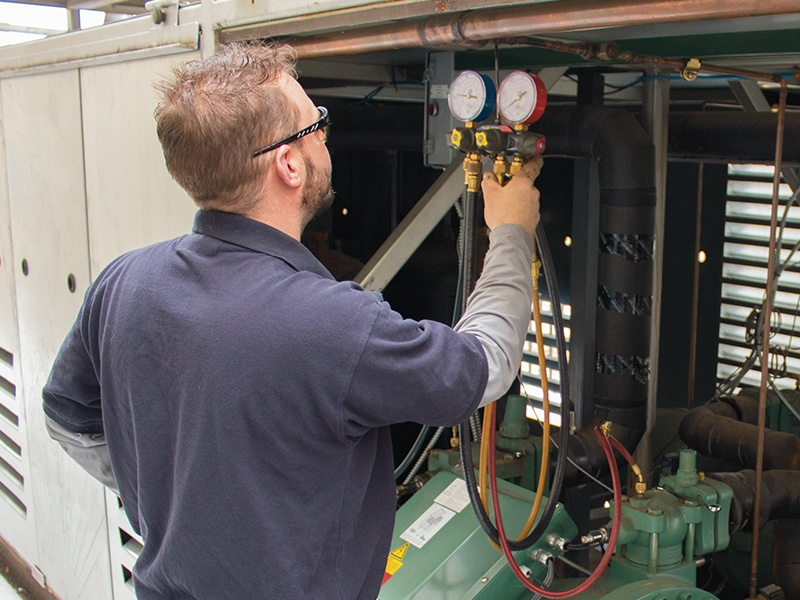 A commercial boiler inspection being performed